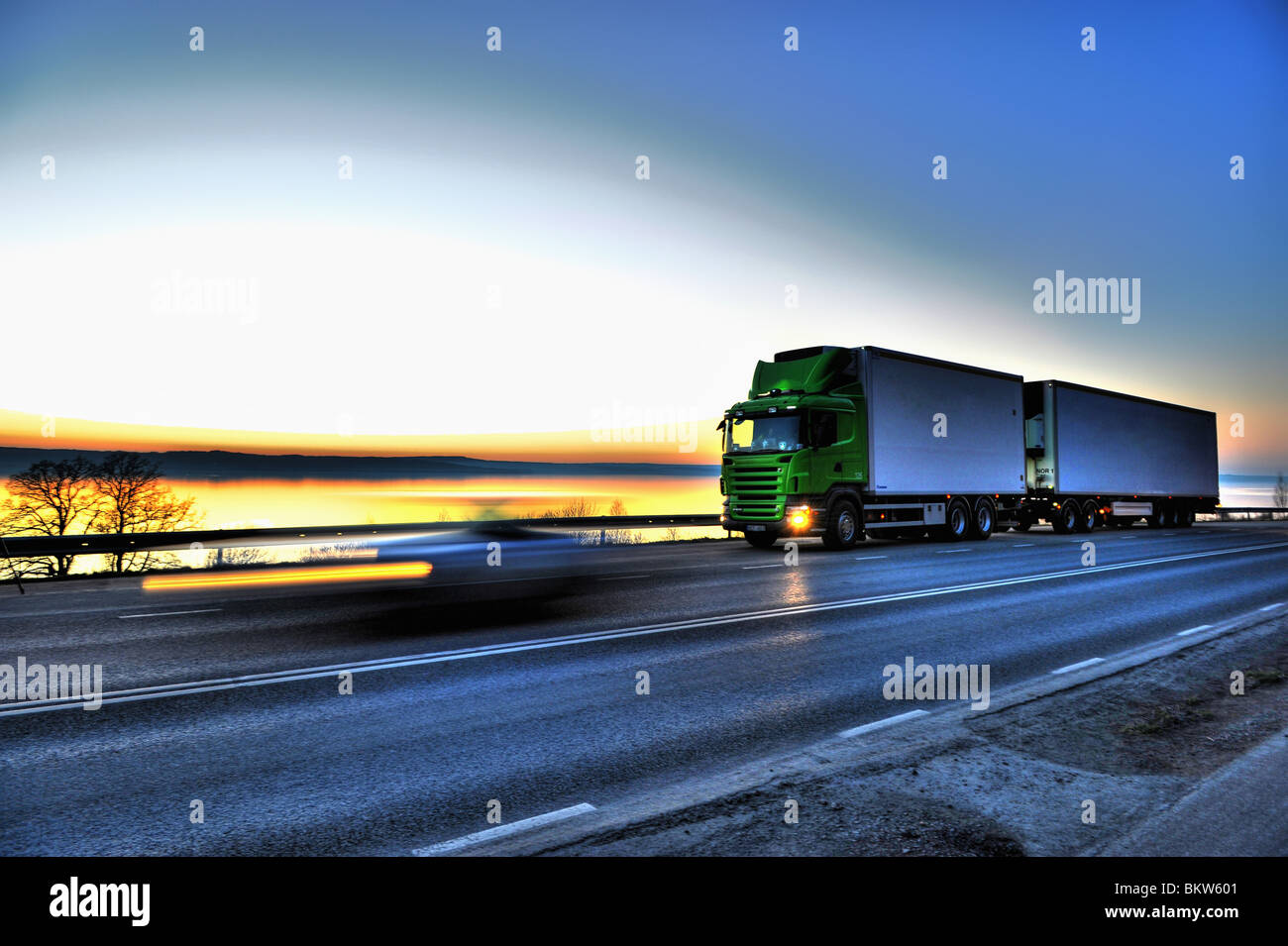 Long-distance lorry against sky Stock Photo