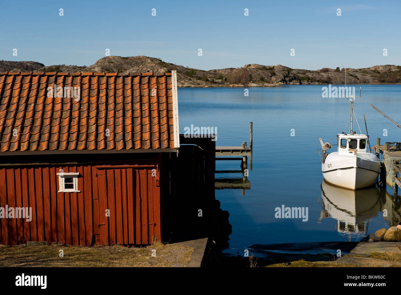 Boathouse and boat - Stock Image
