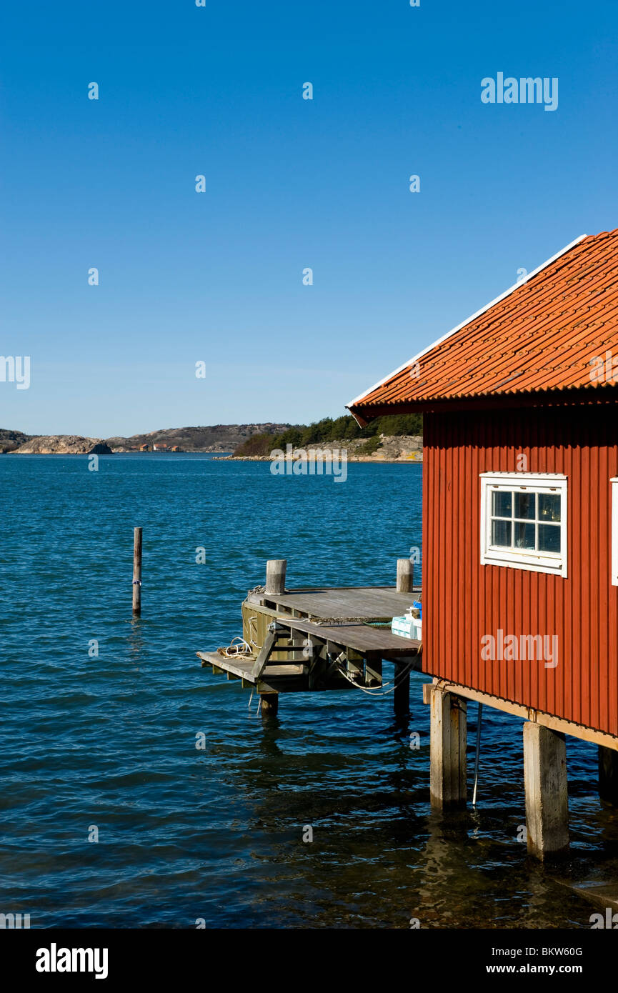 Boathouse by water - Stock Image