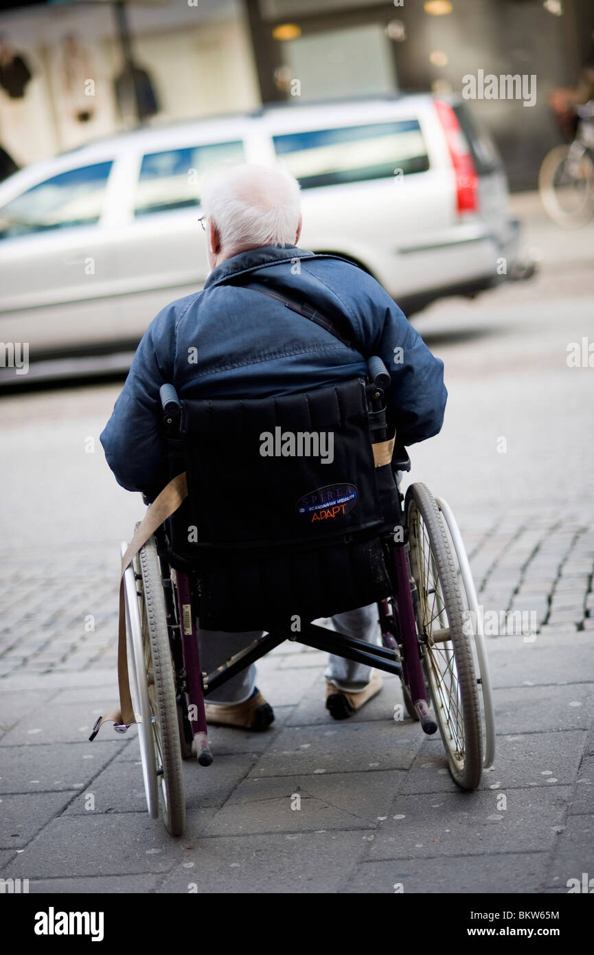Man in wheelchair - Stock Image