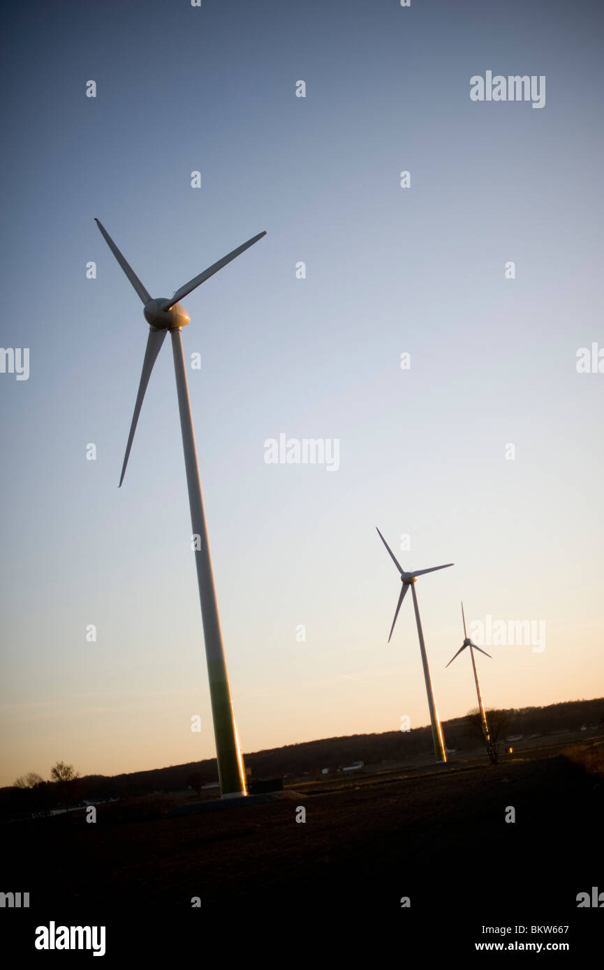 Three wind power stations in dusk - Stock Image