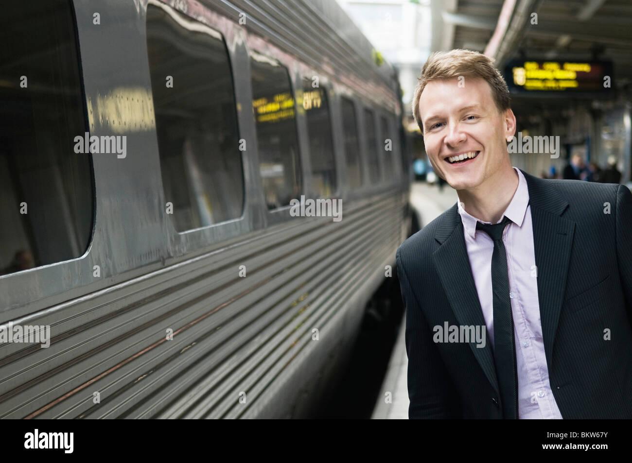 Businessman waiting on station Stock Photo