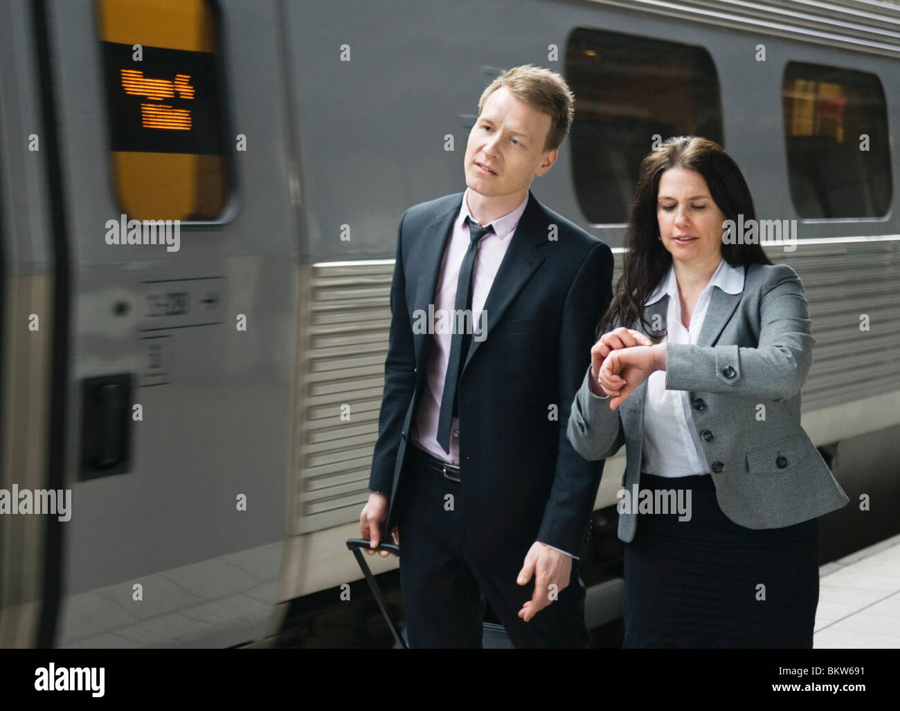 Two people by the train Stock Photo