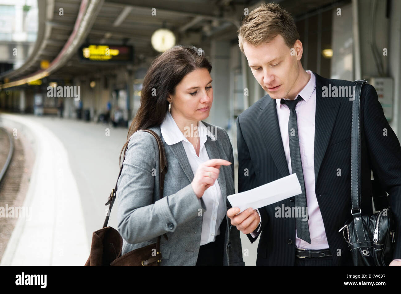 Woman and am nchecking the ticket - Stock Image