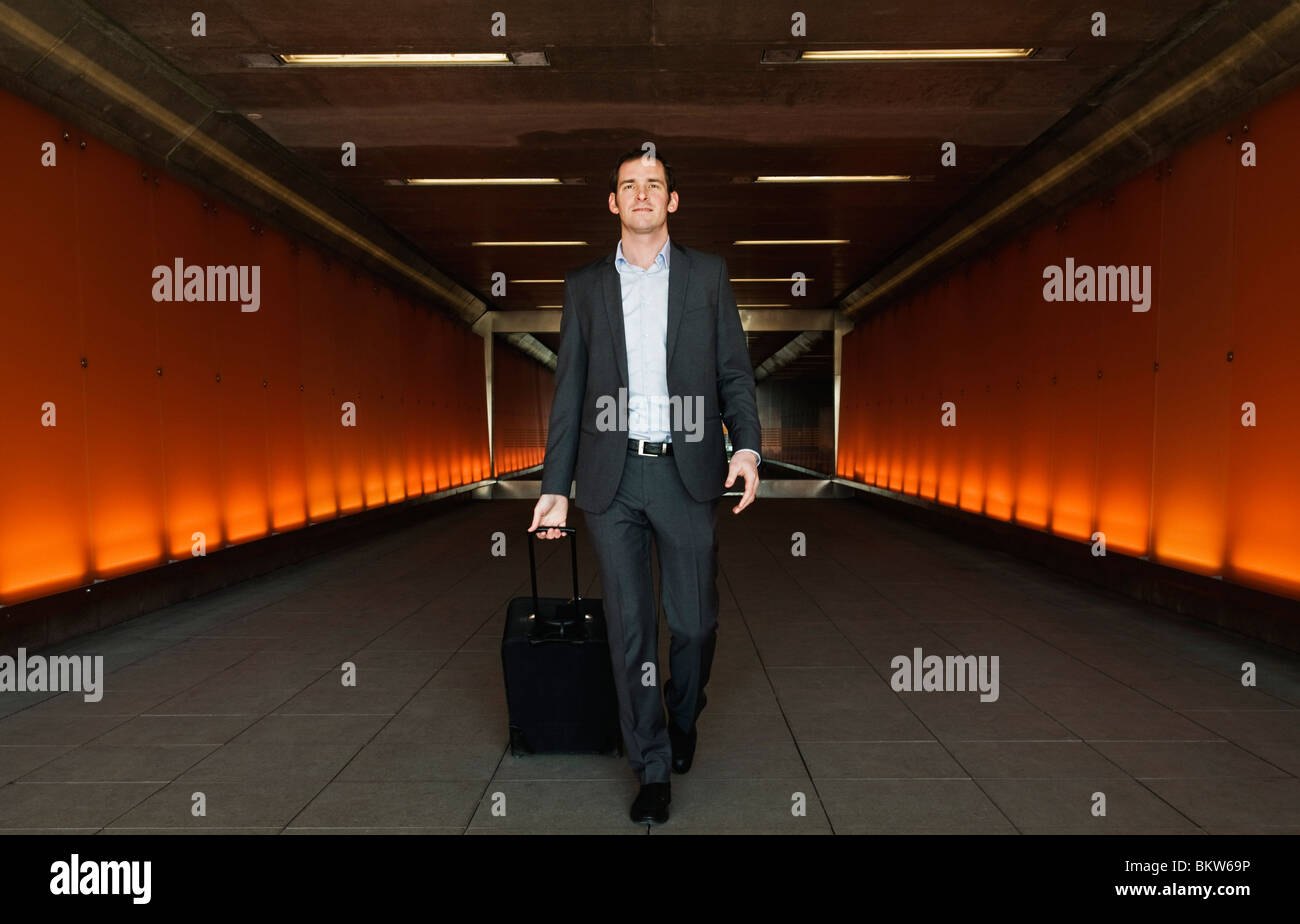 Man walking down passage - Stock Image