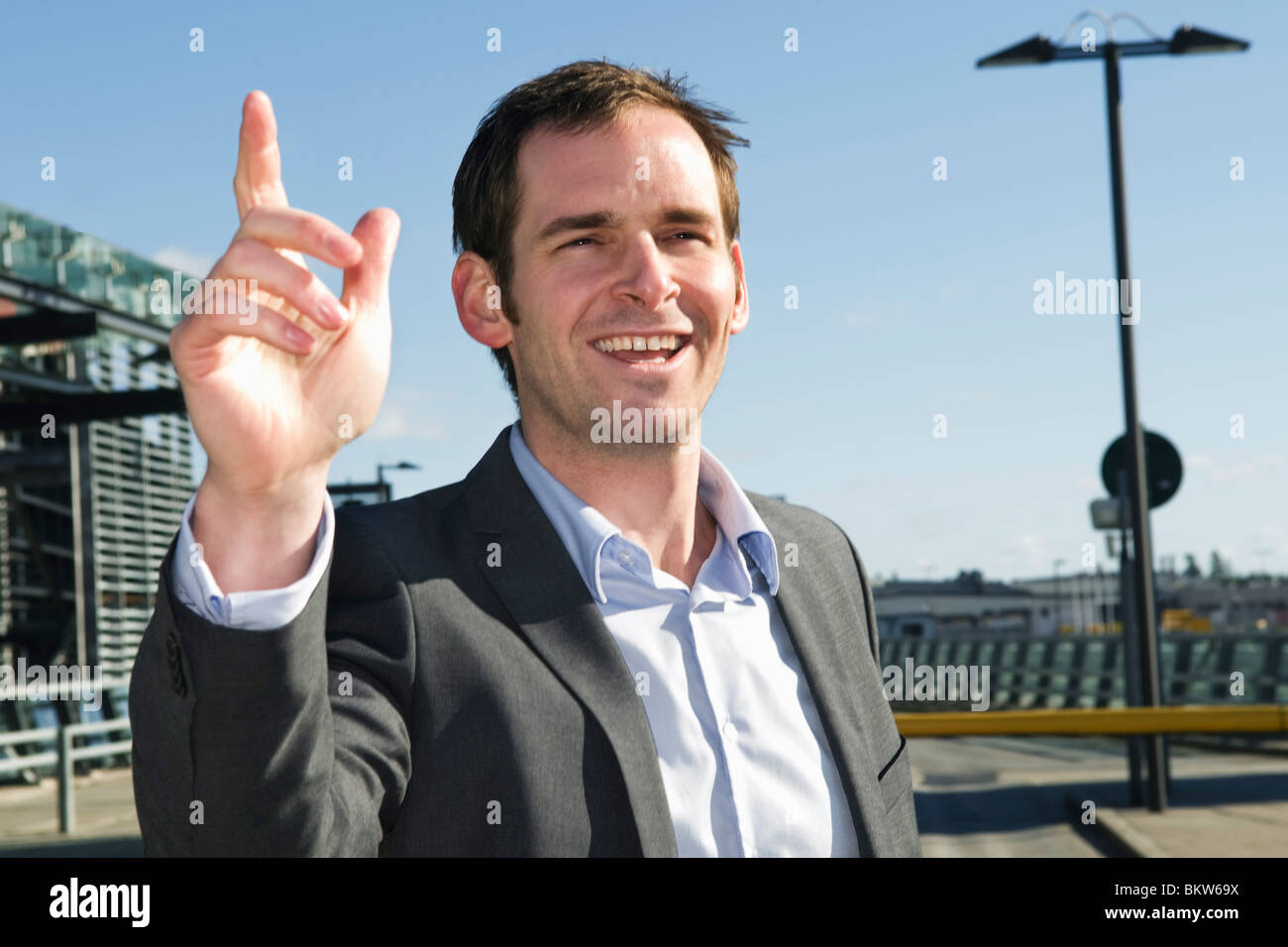 Man outside airport - Stock Image