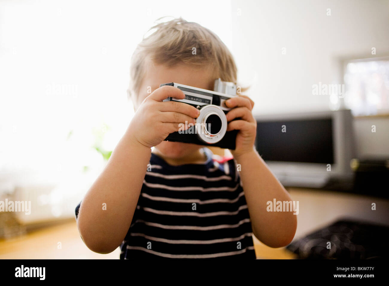 Child with camera - Stock Image
