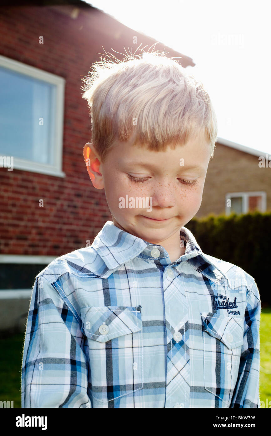 Boy in checked shirt - Stock Image