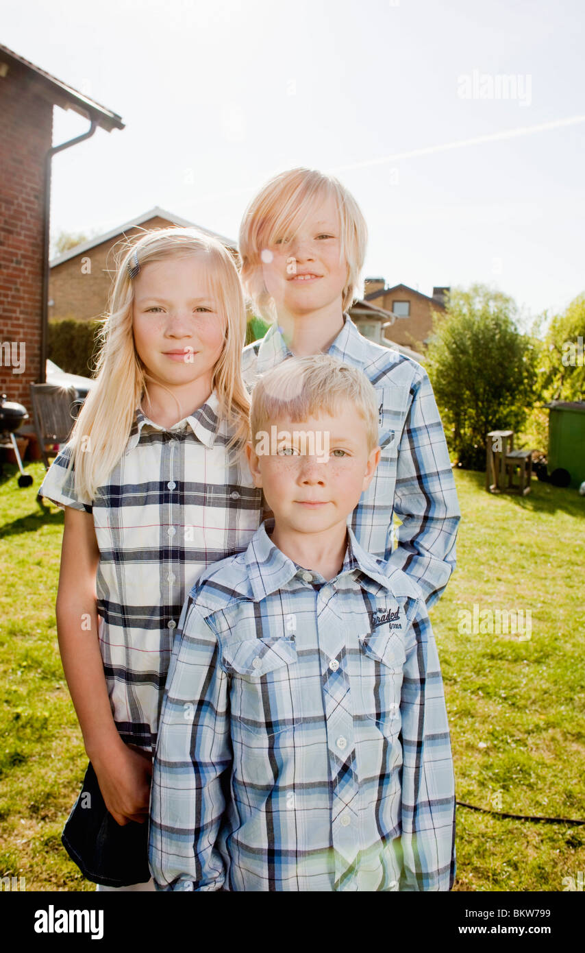Three siblings - Stock Image