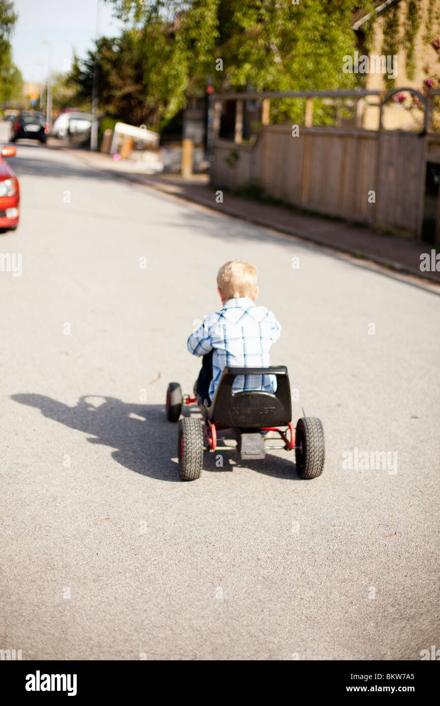 Boy on pedal cycle - Stock Image