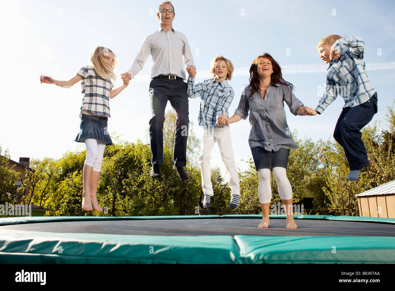 Family bouncing - Stock Image
