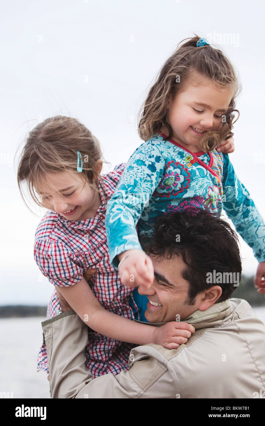 Man with two kids - Stock Image