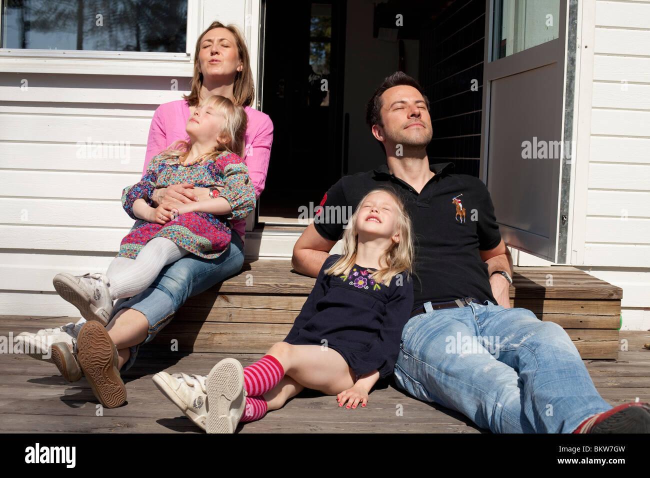 Family enjoying the sun - Stock Image