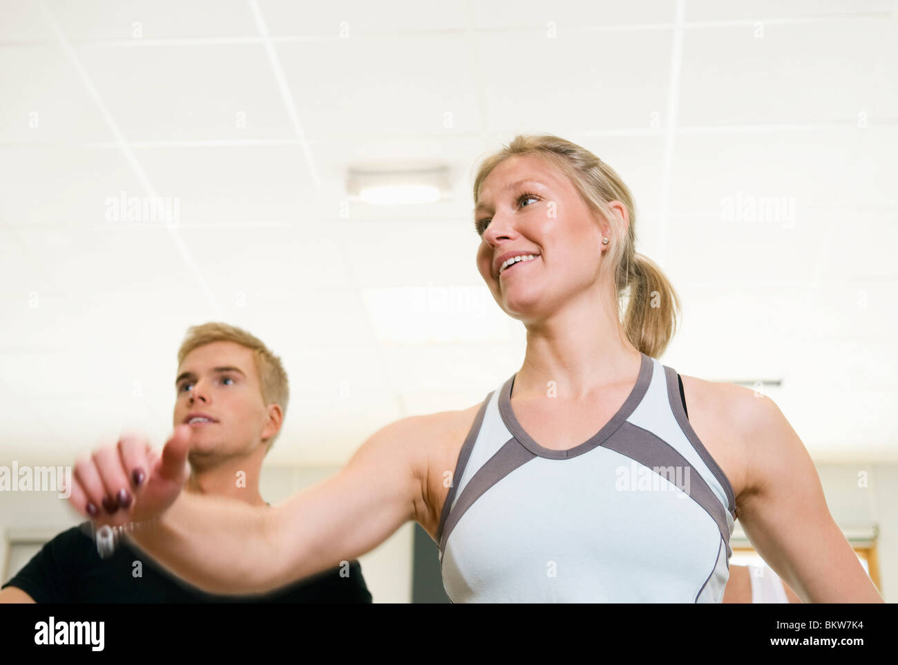 Girl and guy working out - Stock Image