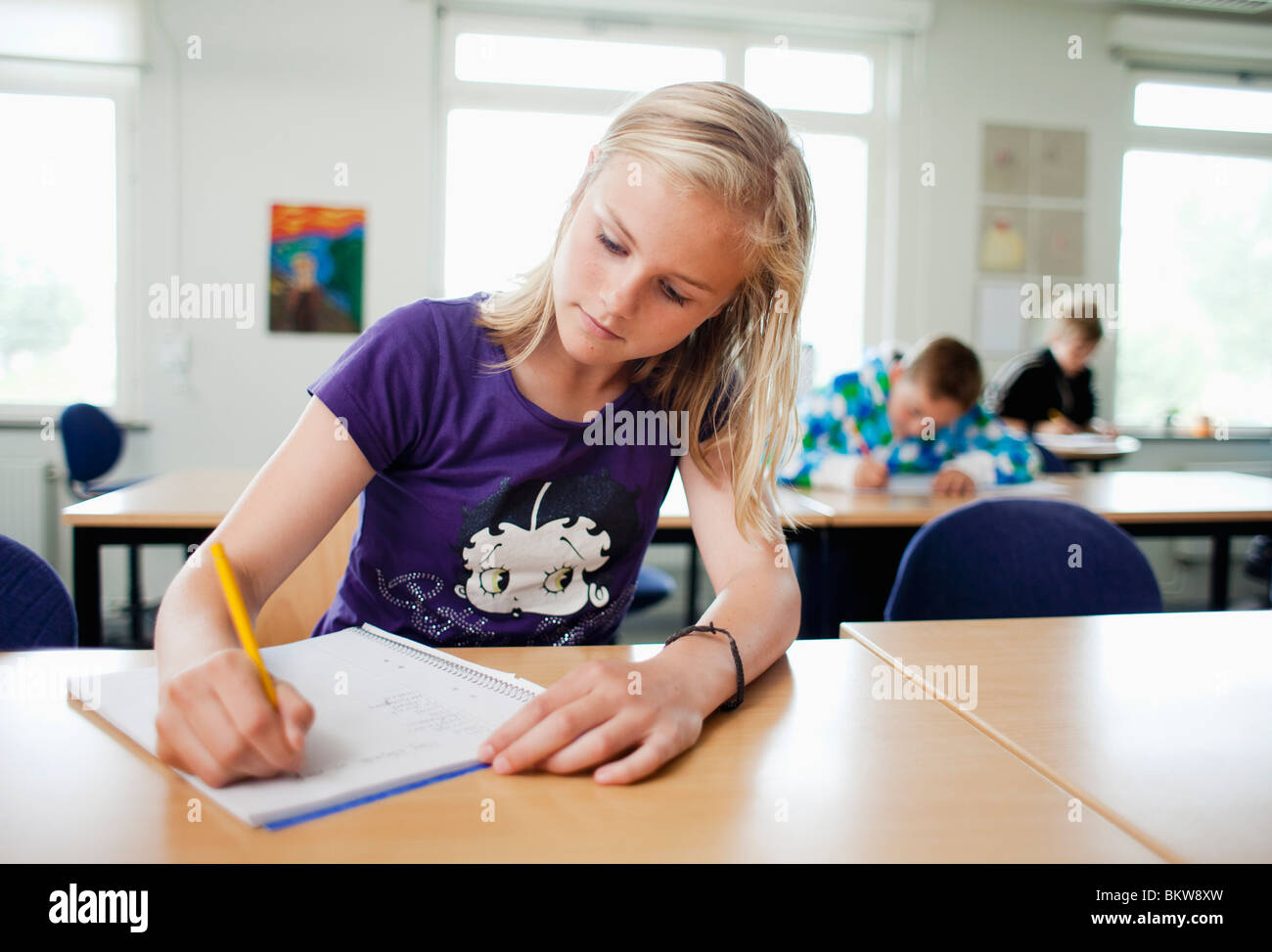 Concentrated girl writing - Stock Image