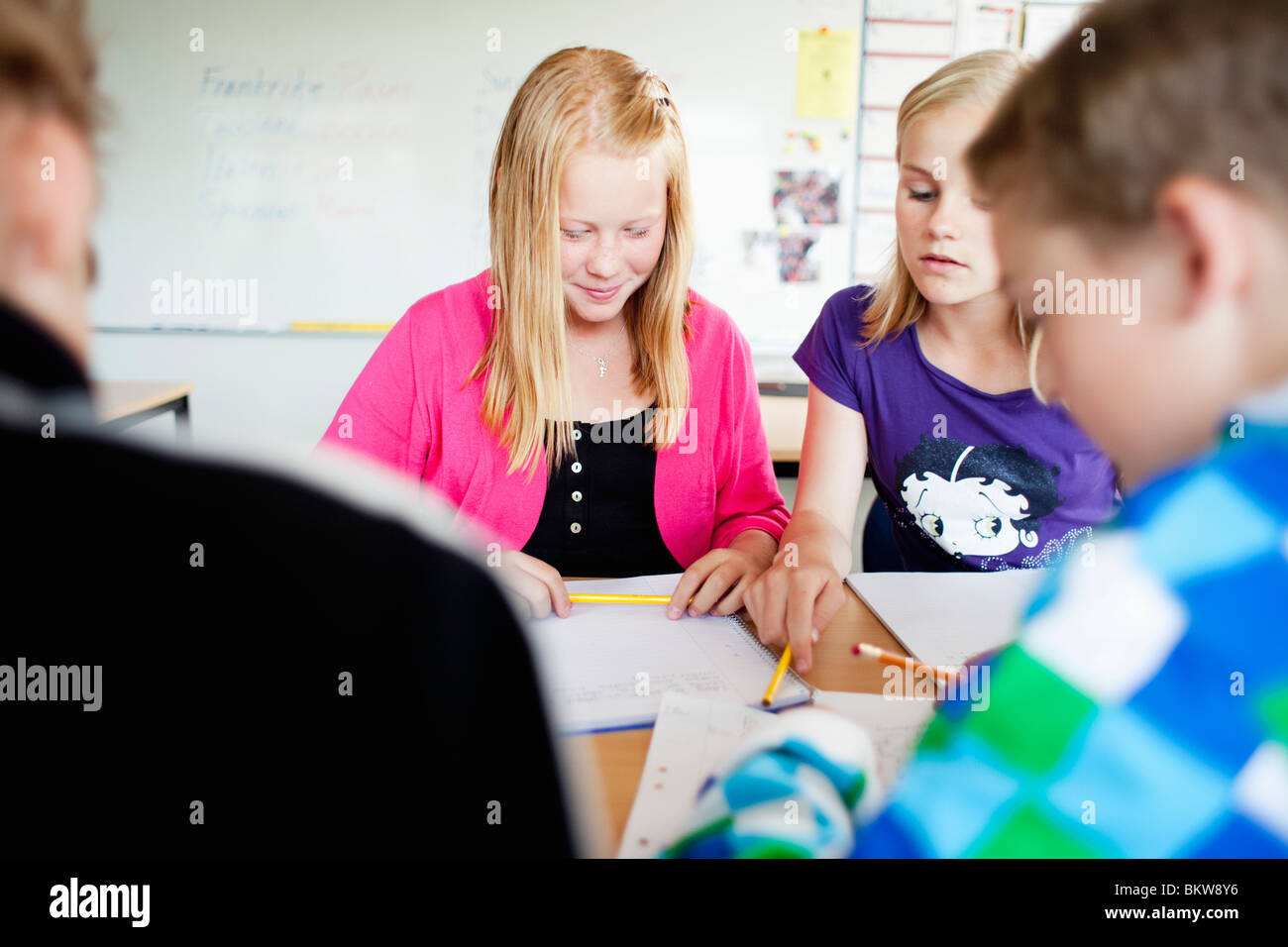 Four students working in team - Stock Image
