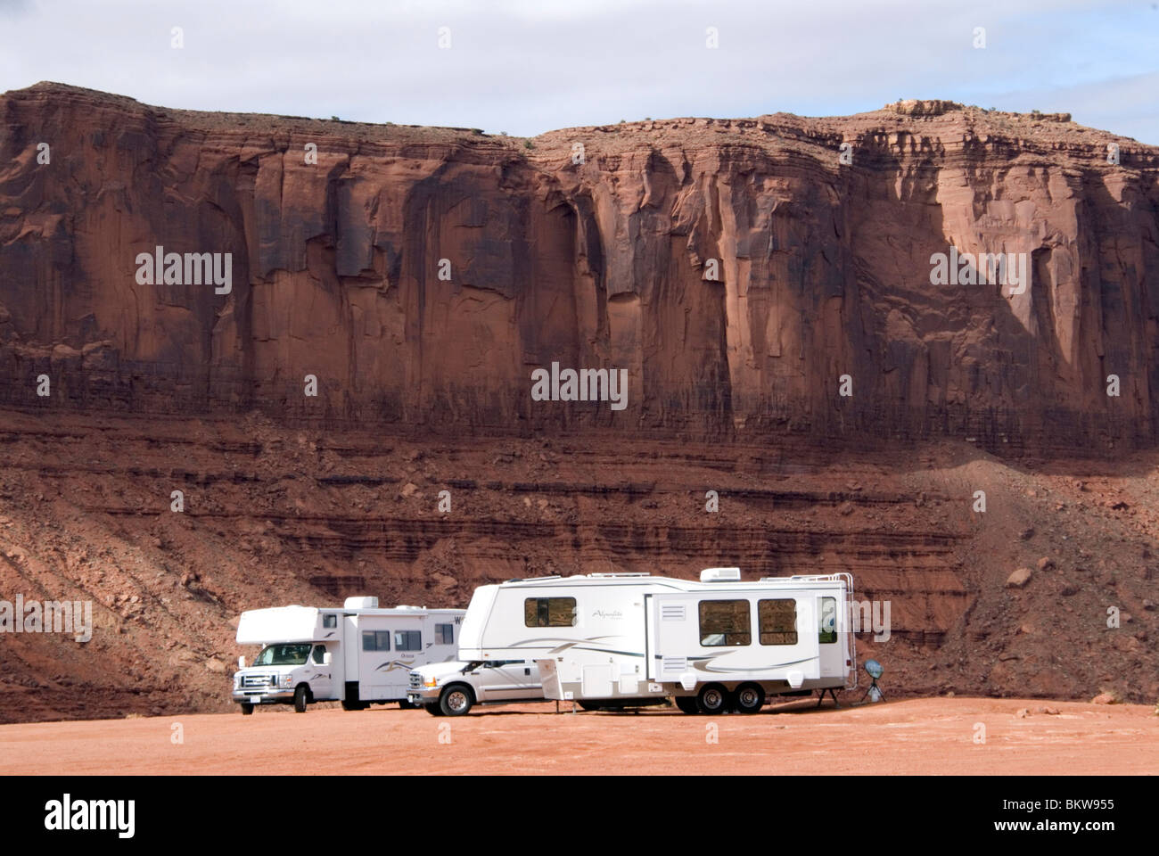 RVs recreational vehicles parked at the primitive campground at the Navajo Tribal Park Visitors Centre Monument - Stock Image