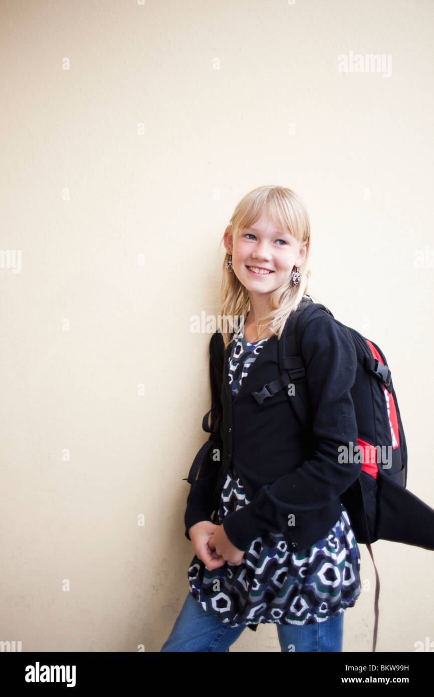 Girl leaning against wall - Stock Image