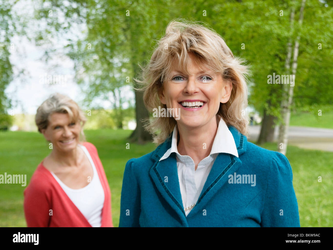 Two grown-up women in the park - Stock Image