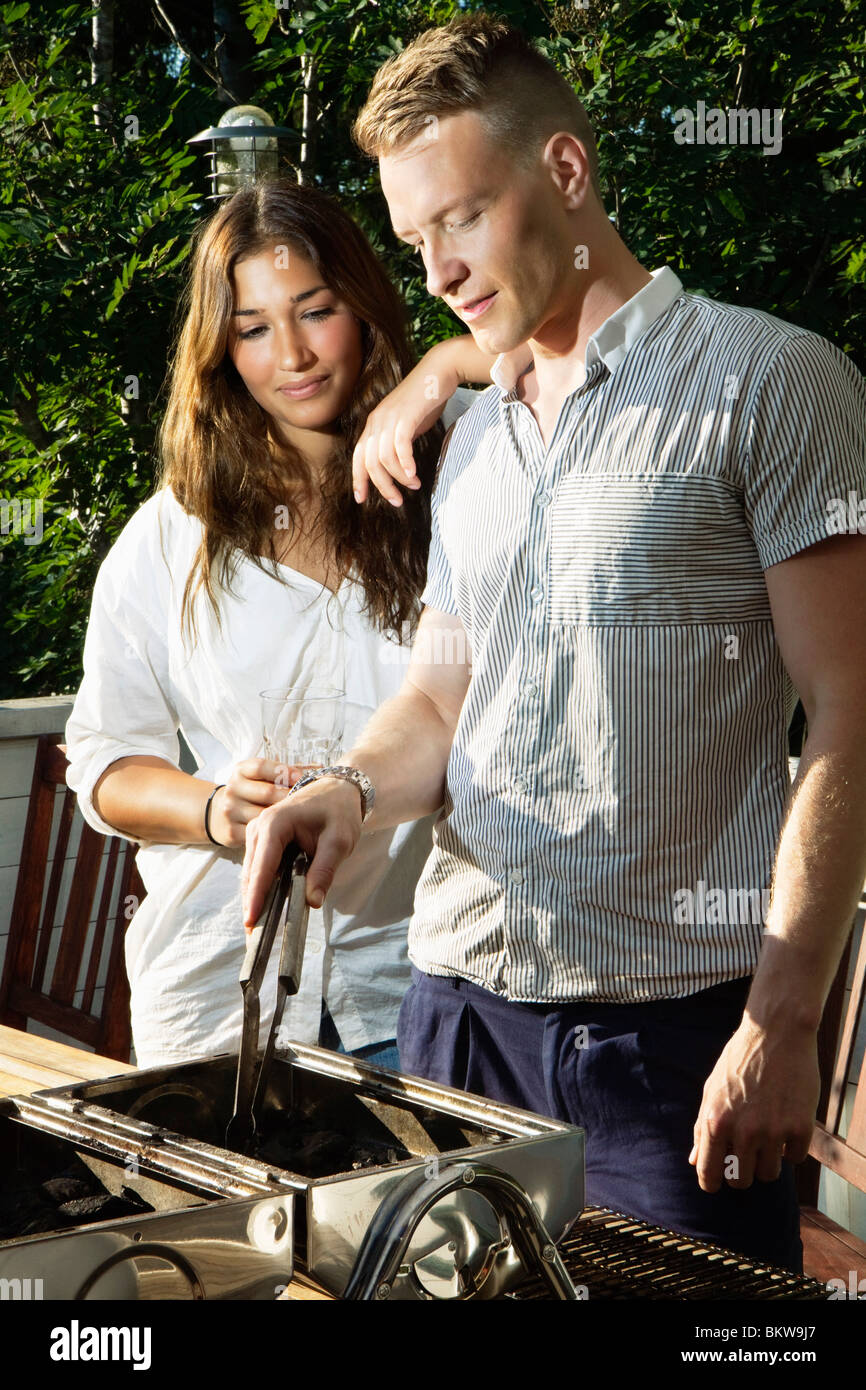 Two persons at grill - Stock Image