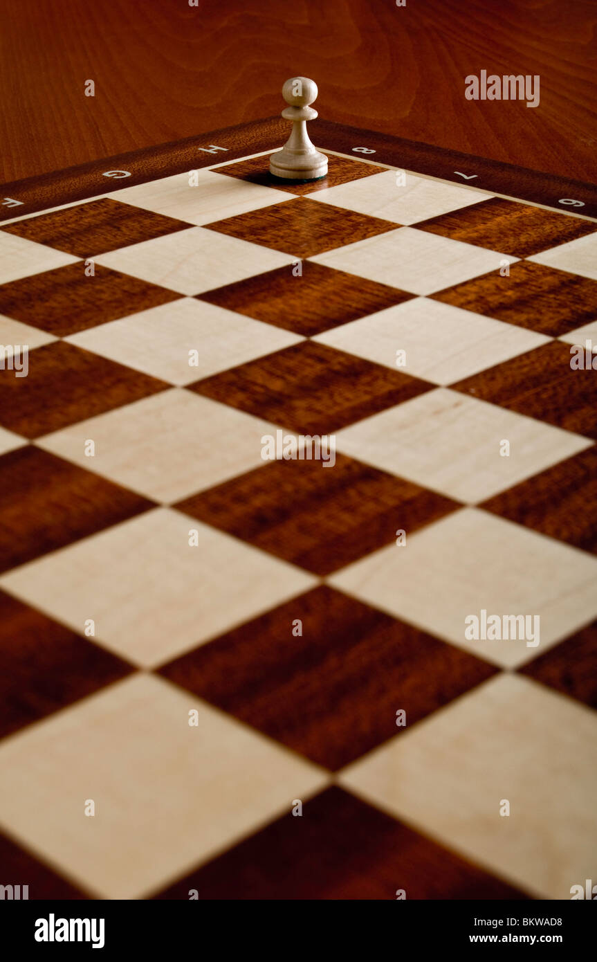 chess pawn on a chessboard - Stock Image