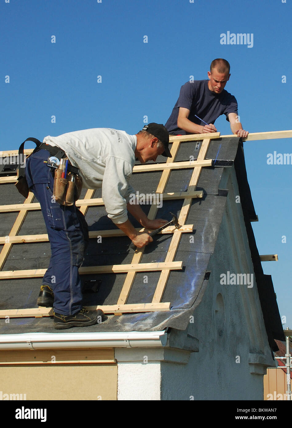 carpenter on roof - Stock Image
