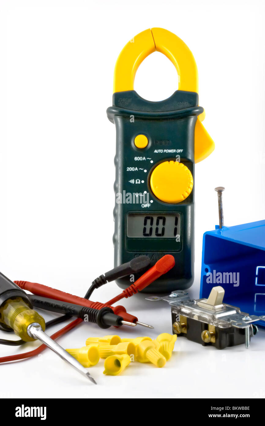close-up image of a electrical meter, switch, electrical box, wire nuts and screwdriver. - Stock Image