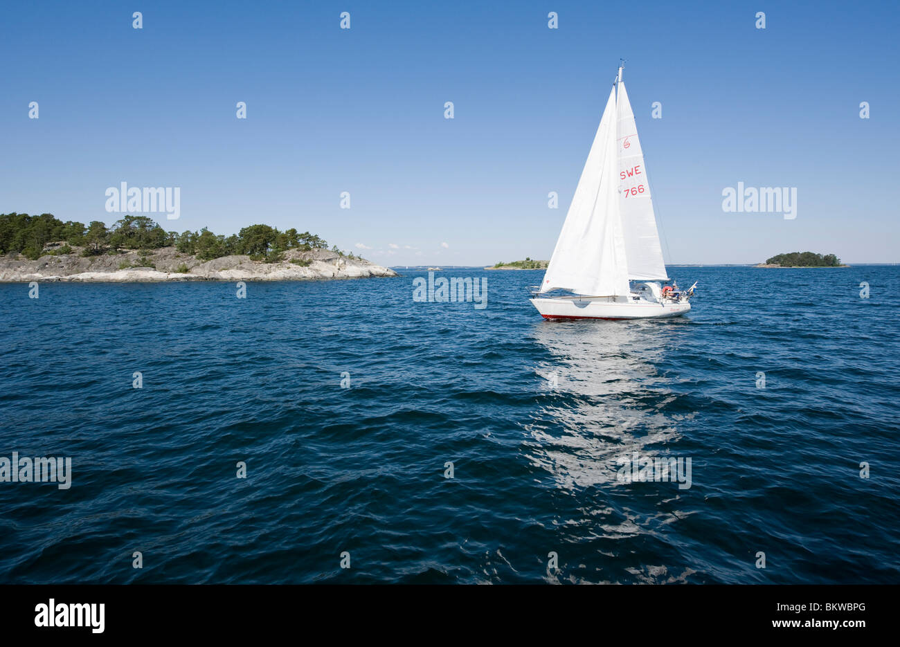 A small sailing boat - Stock Image