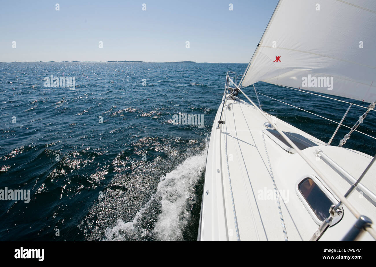 Sailing boat going fast over open water - Stock Image