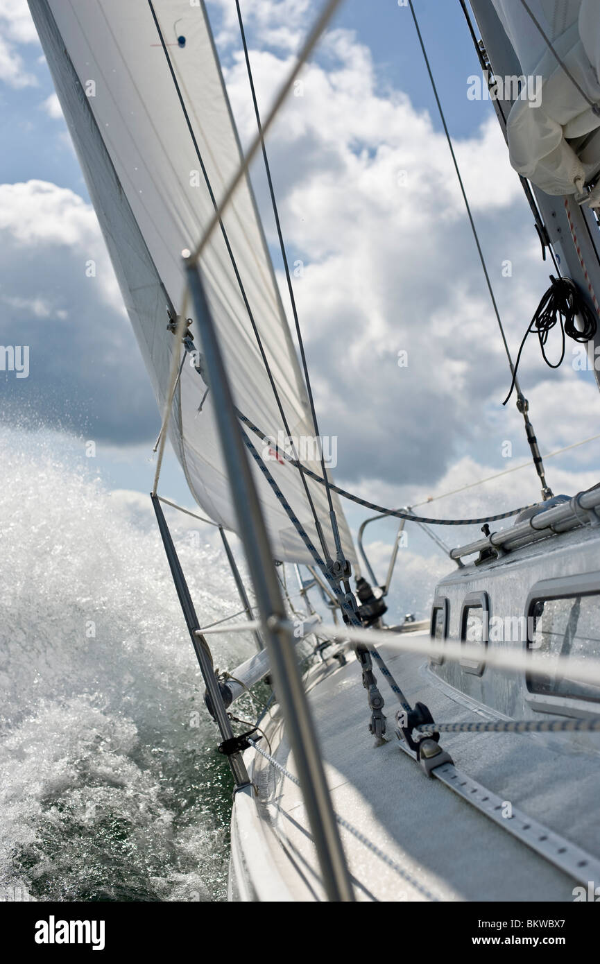 Closeup on fast sailing boat - Stock Image