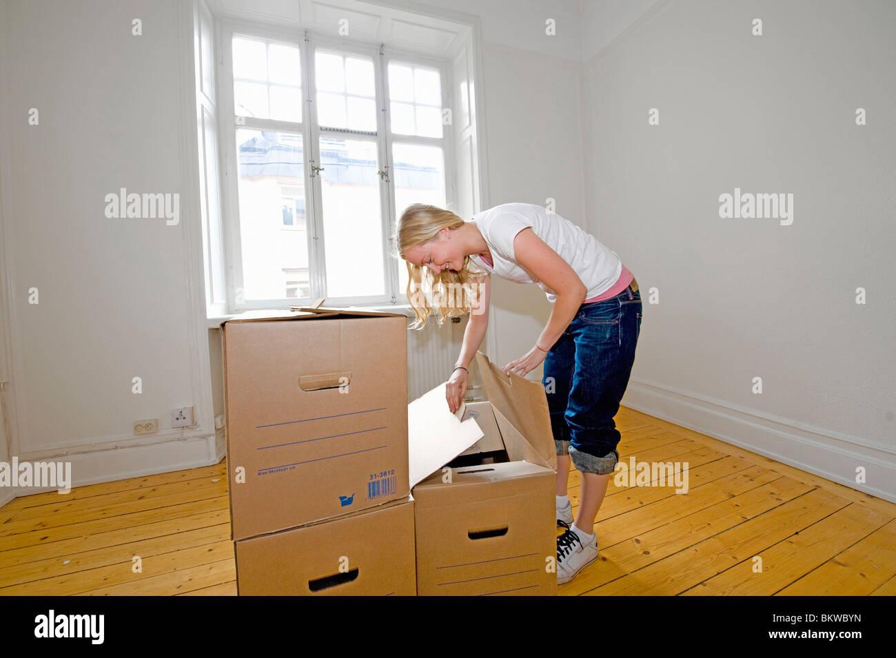 Woman looking inside box - Stock Image