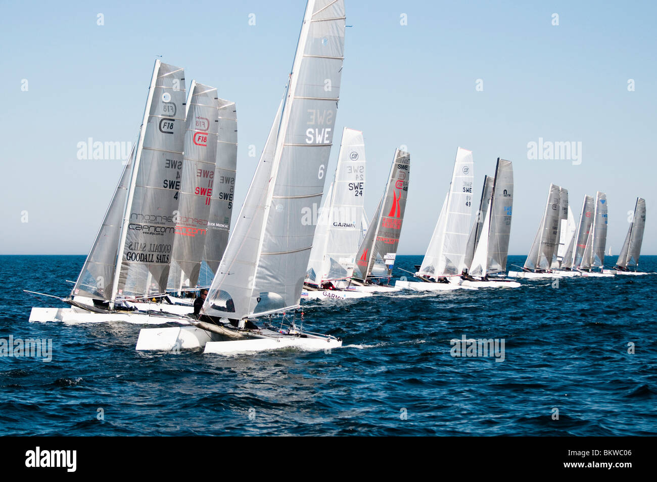 Sailboats in a row - Stock Image