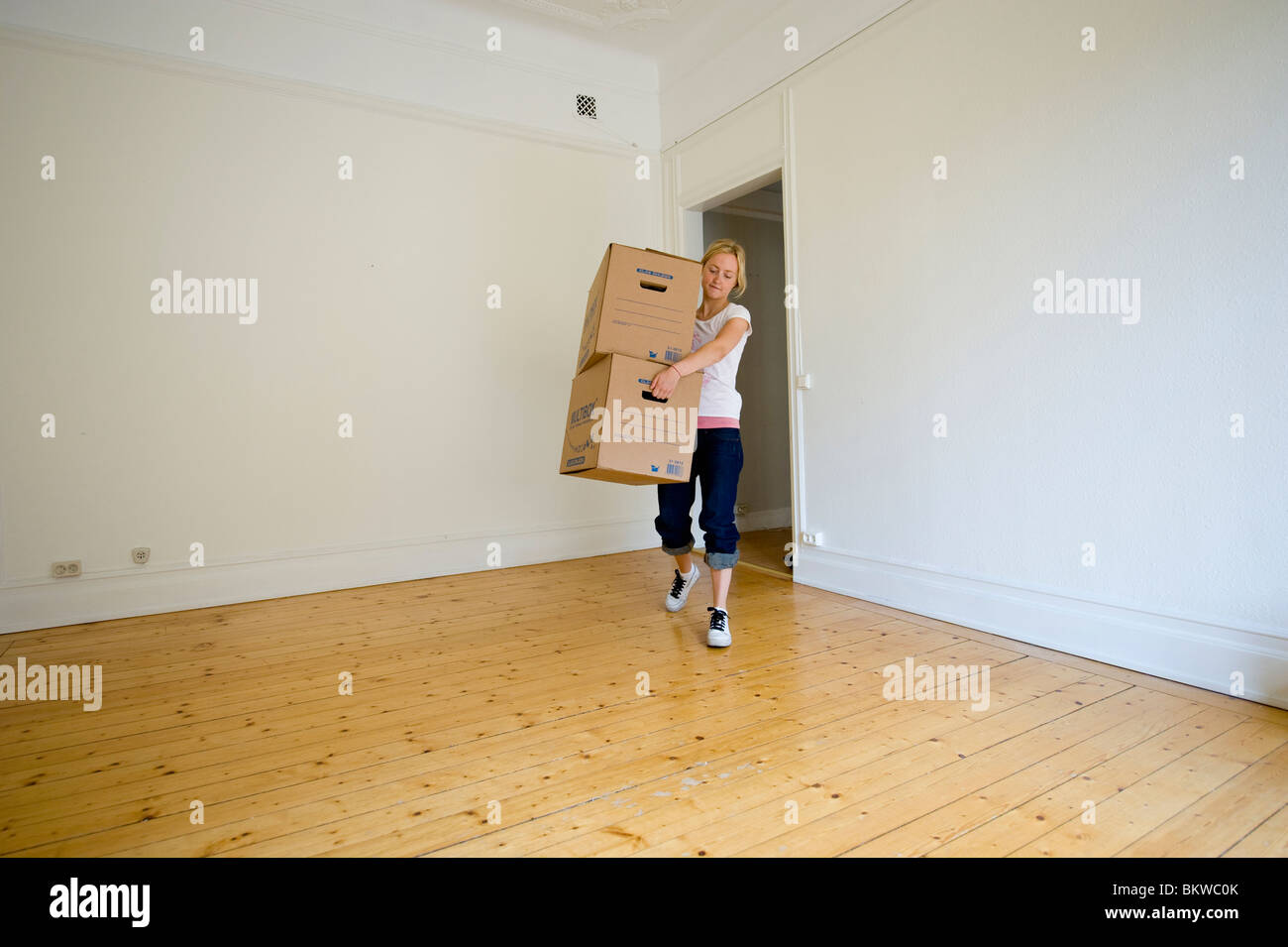 Woman with moving boxes Stock Photo