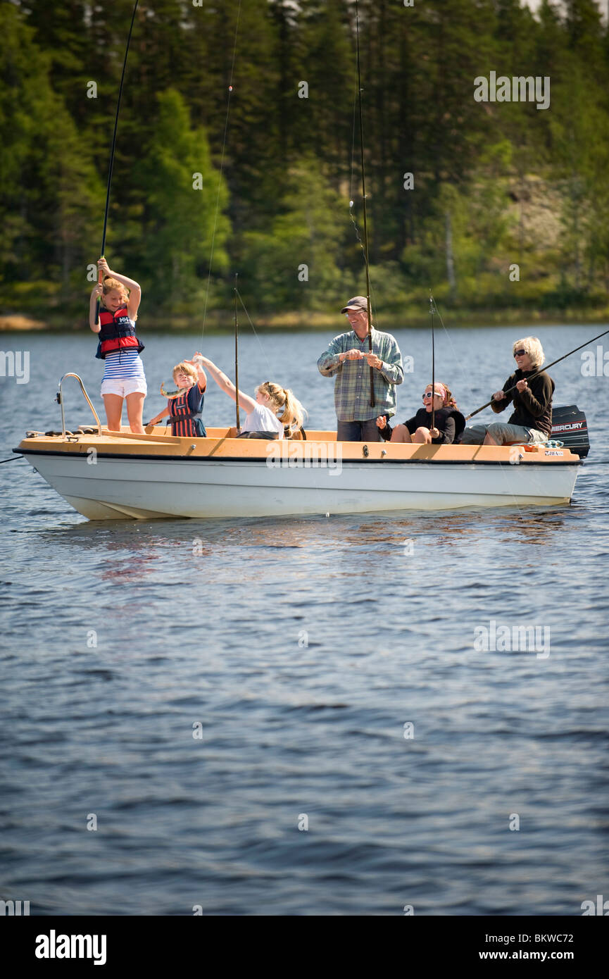Six people in a boat - Stock Image