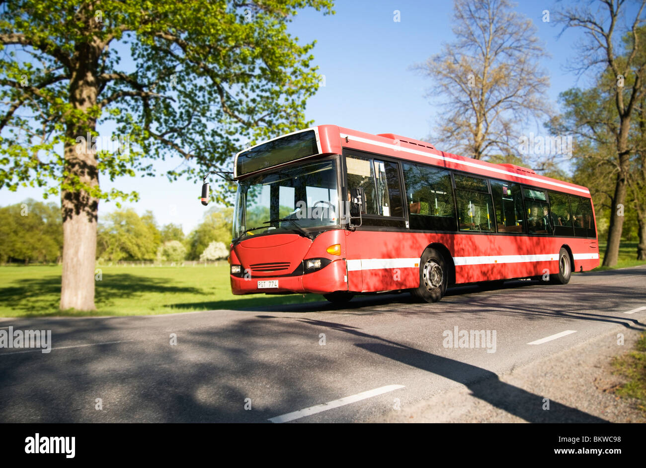 Bus standing by the verge - Stock Image