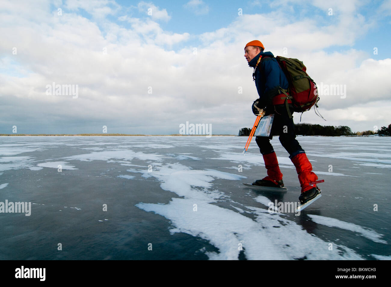 Man on ice skates - Stock Image