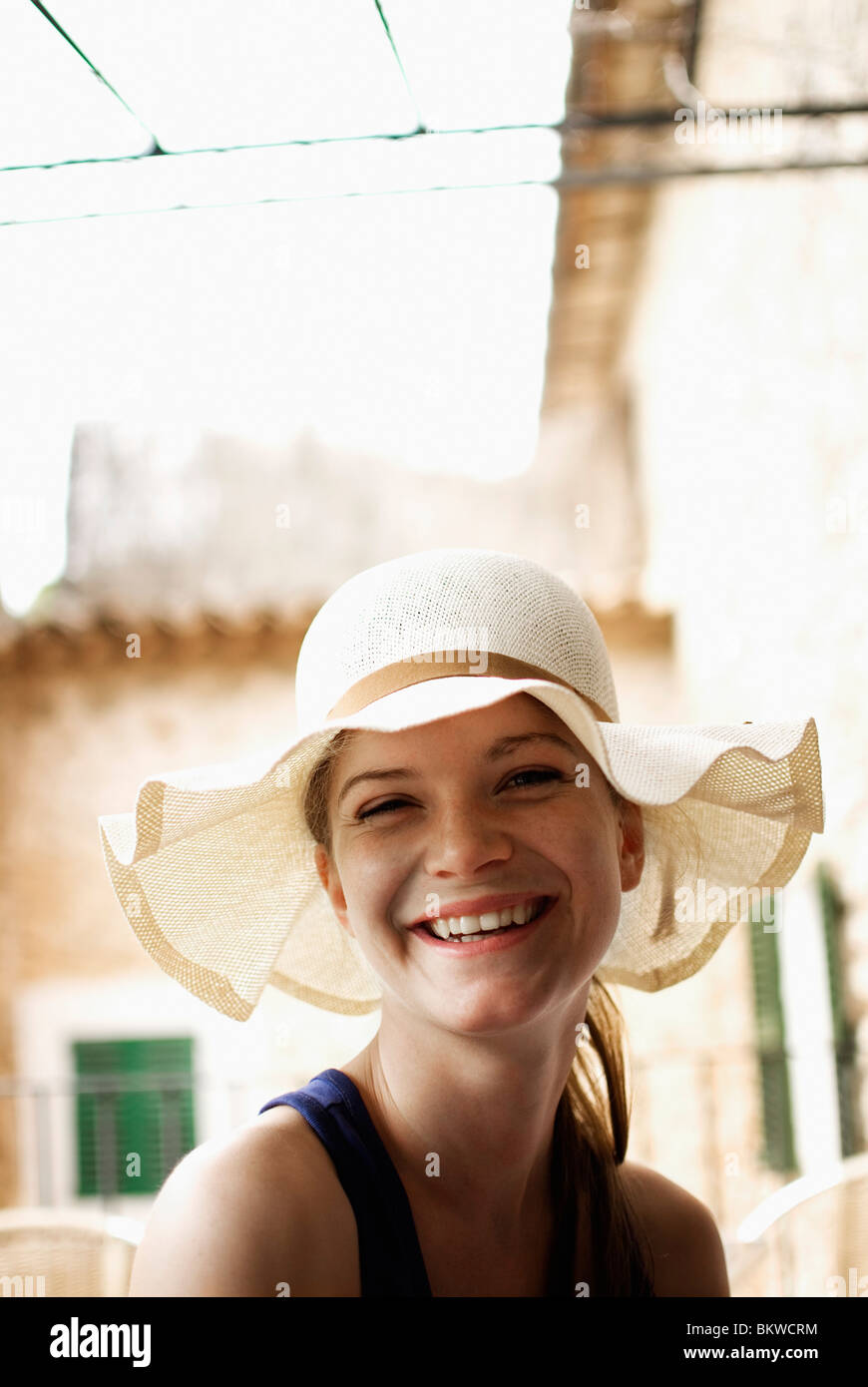 Smiling woman in hat - Stock Image
