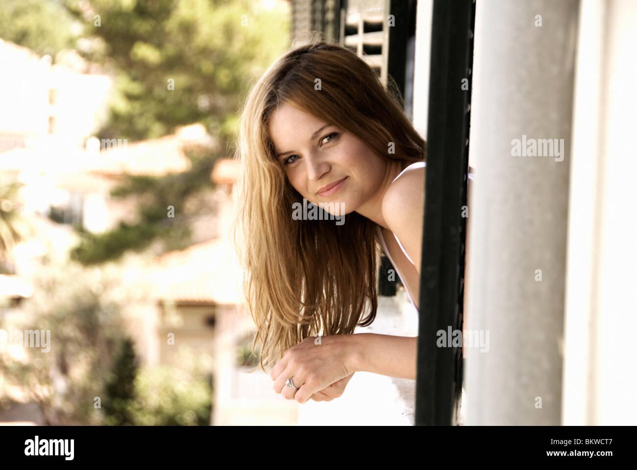 Woman in window - Stock Image