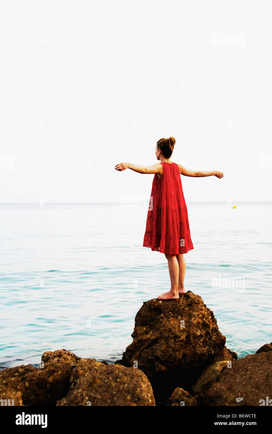 Woman in red dress - Stock Image