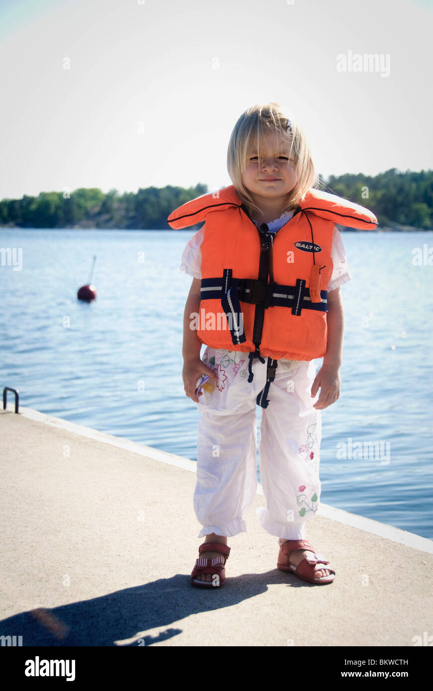 Girl in life jacket - Stock Image