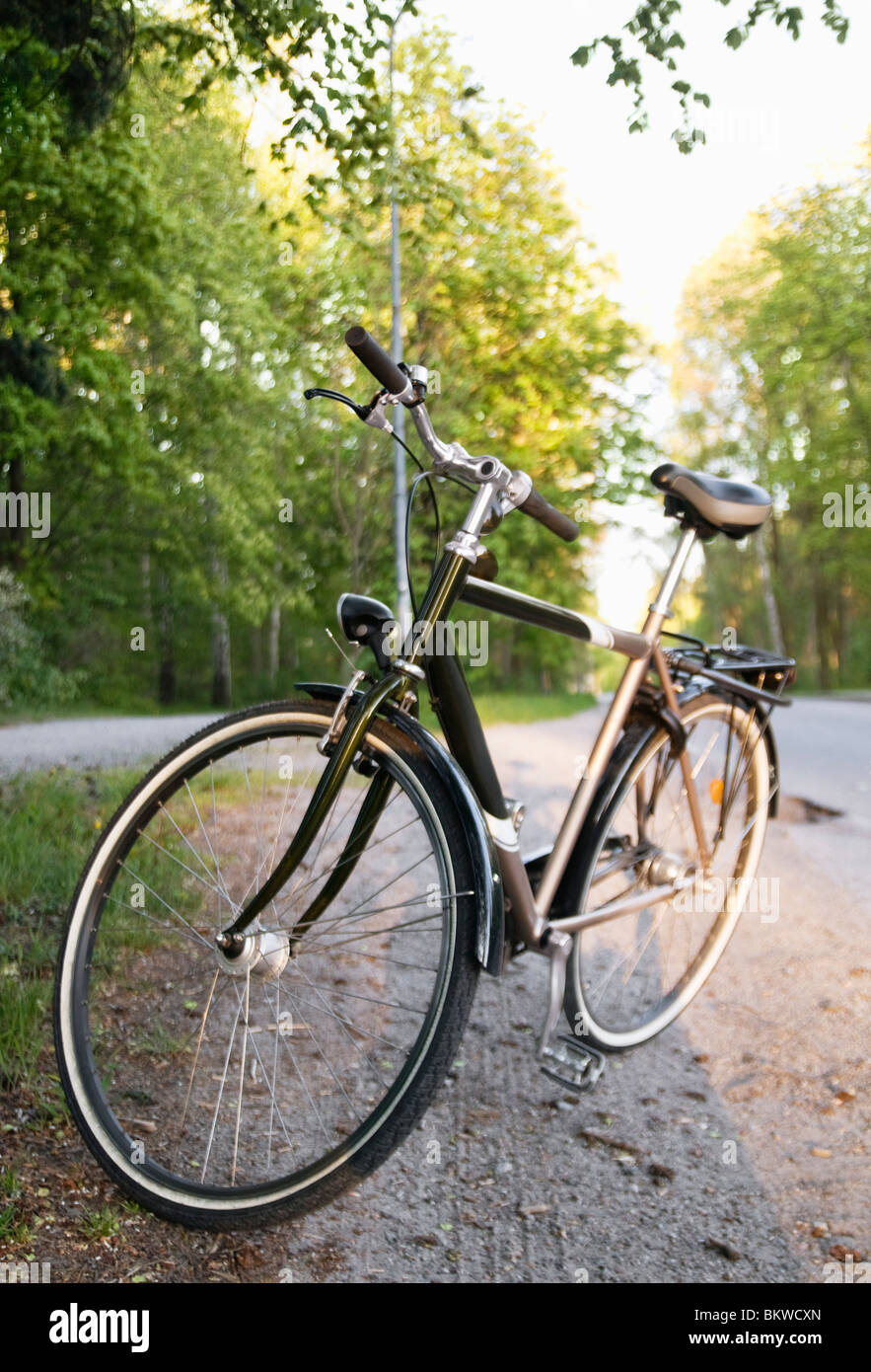 Cycle by gravel road - Stock Image