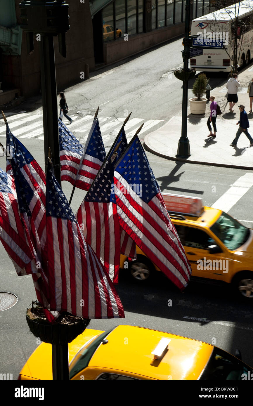 42nd Street US Flags and Taxis - Stock Image