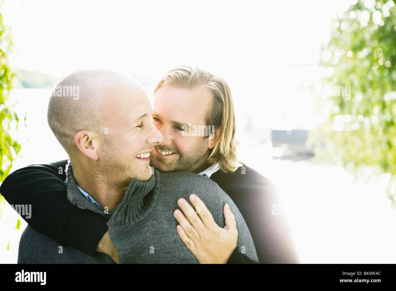 Two gay men holding each other Stock Photo: 29448732 - Alamy