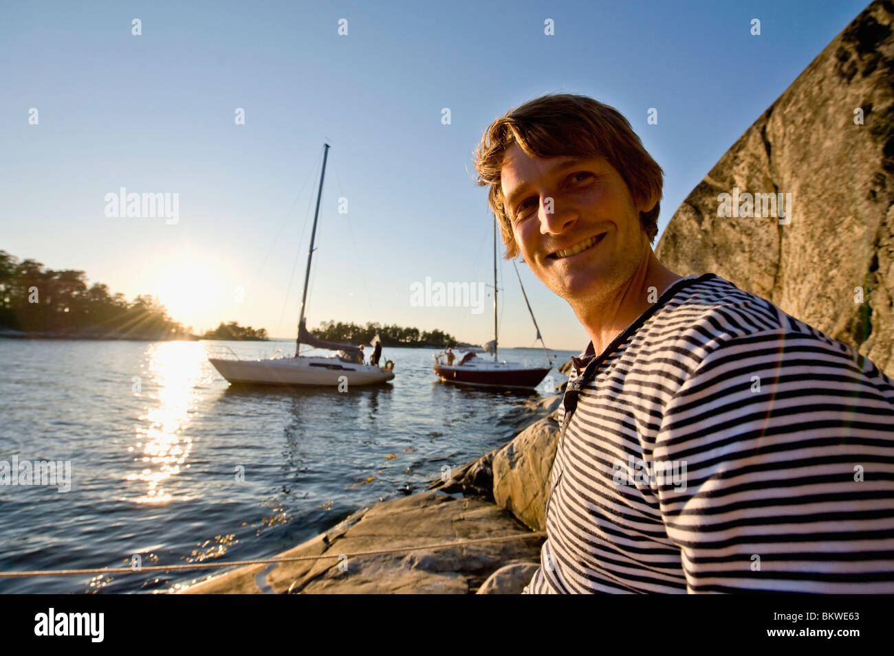 A man sitting in the archipelago - Stock Image