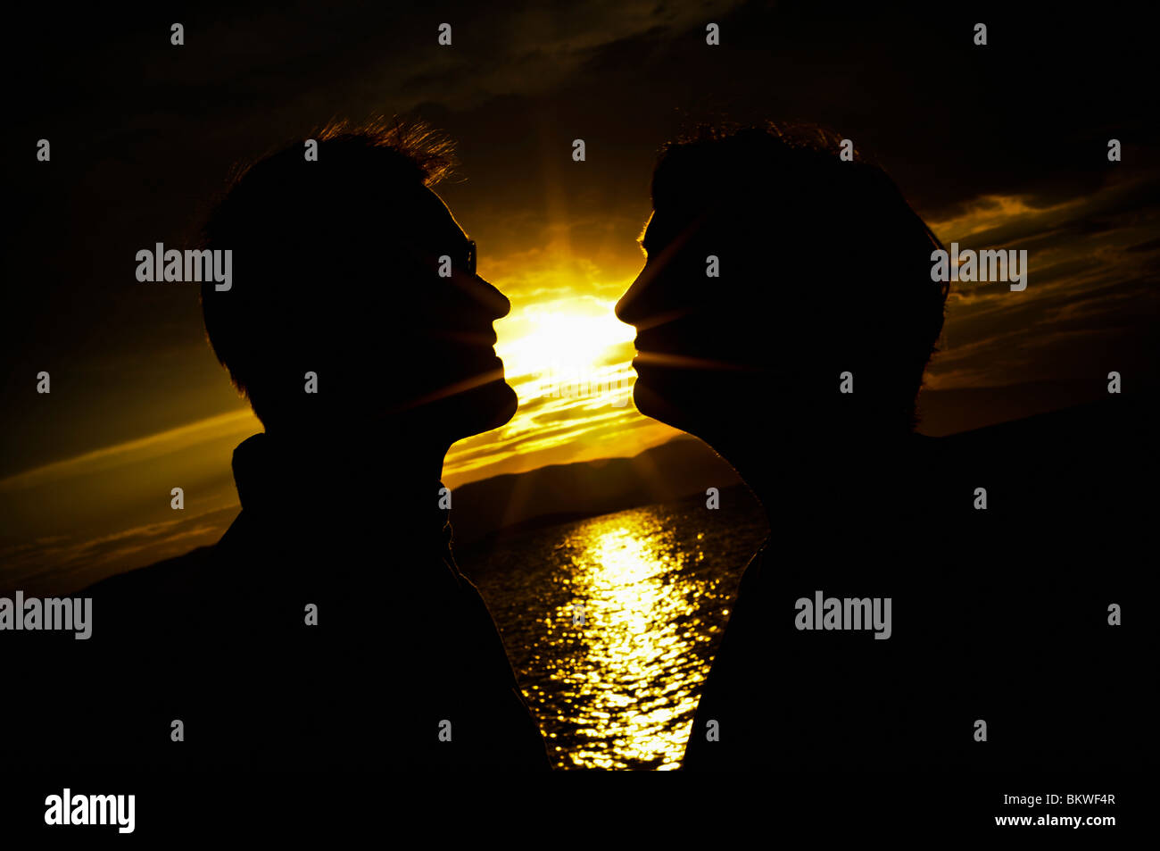 Two men and a beautiful sunset - Stock Image