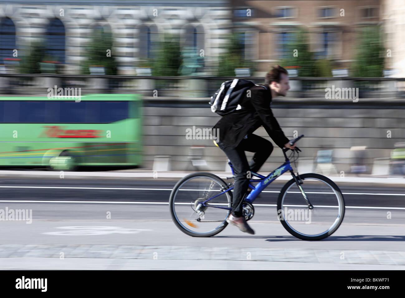 Man biking on cycle lane - Stock Image