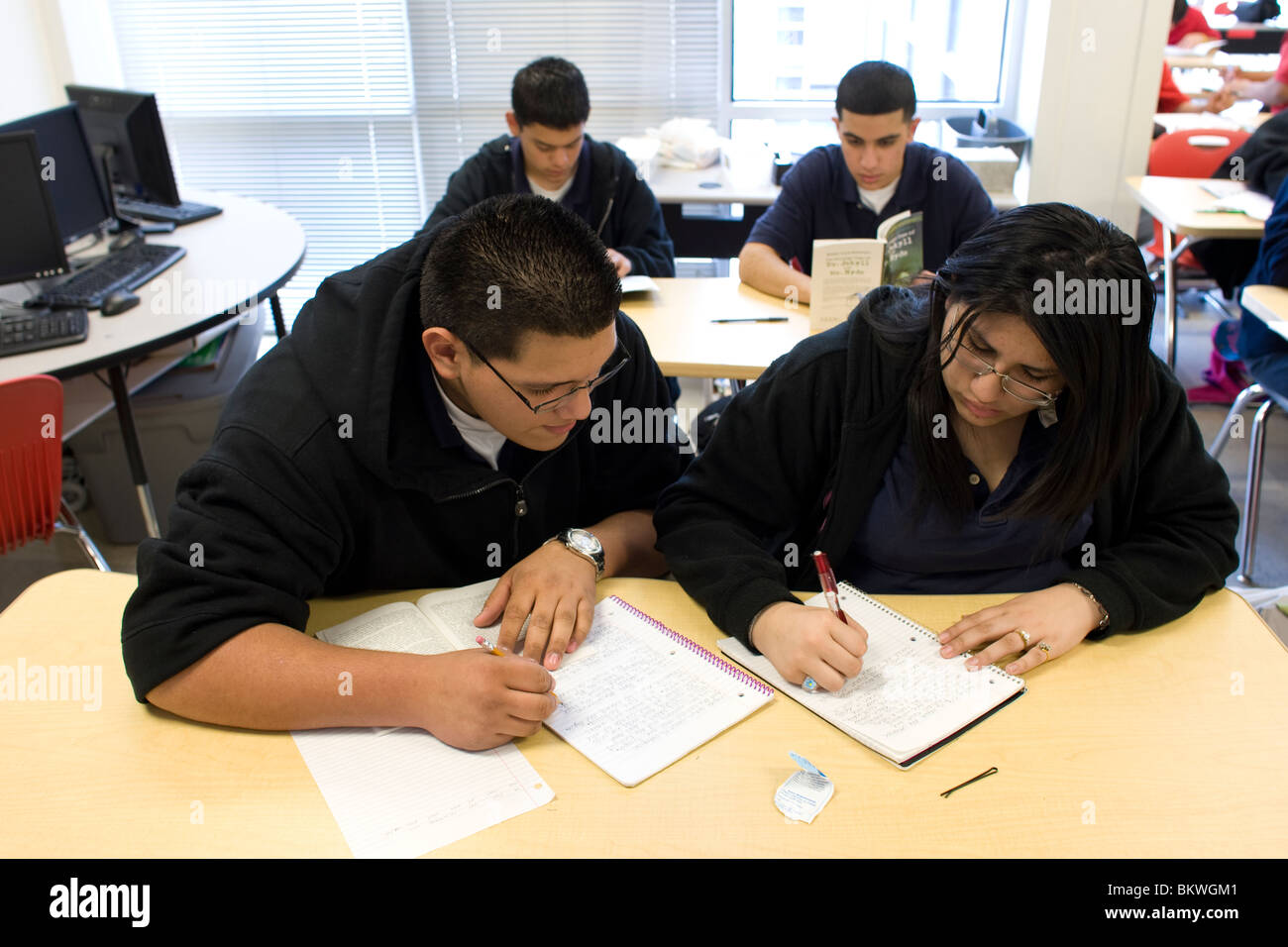Male And Female High School Students Work Together In Class At Stock