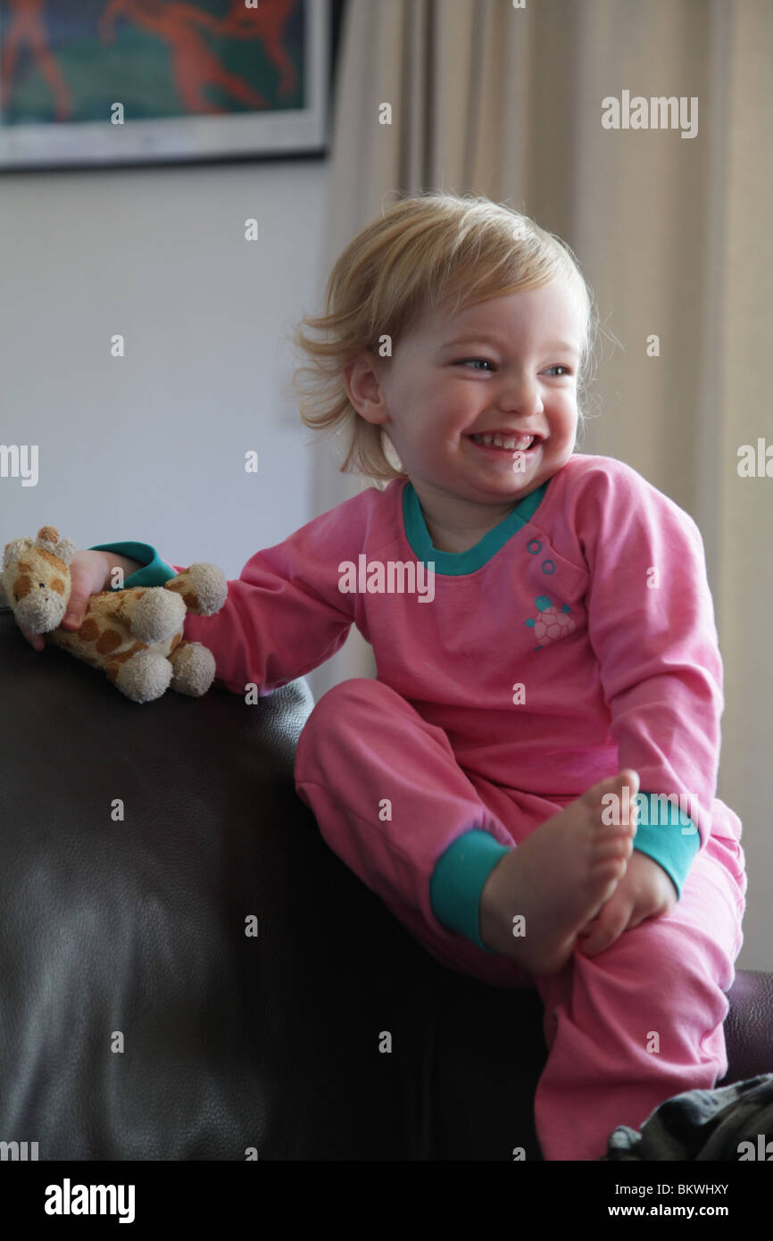 Two Year Old Child Baby Girl Sit Sitting Sat Sofa Couch