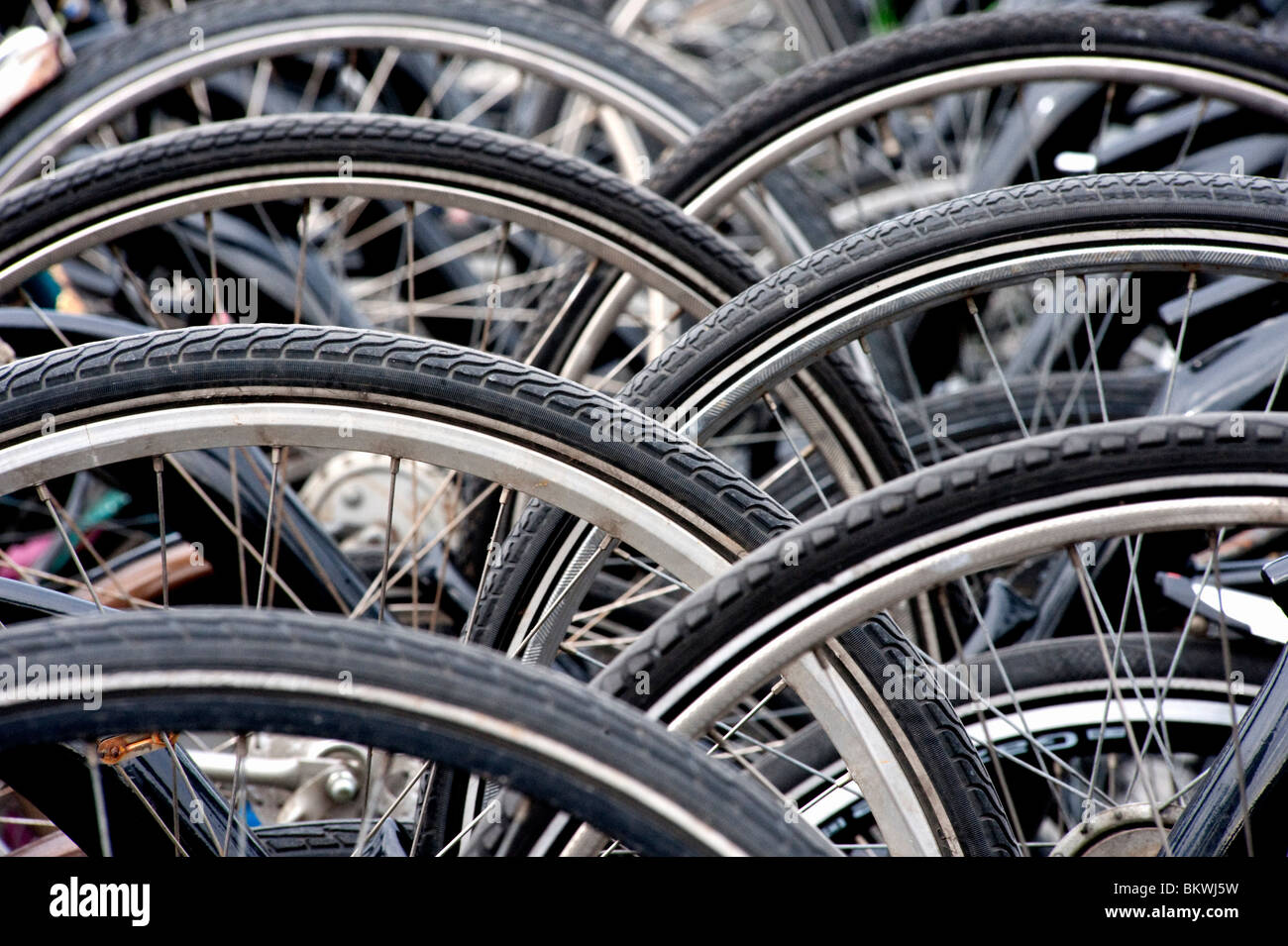 Many bicycles parked outside in city in The Netherlands - Stock Image