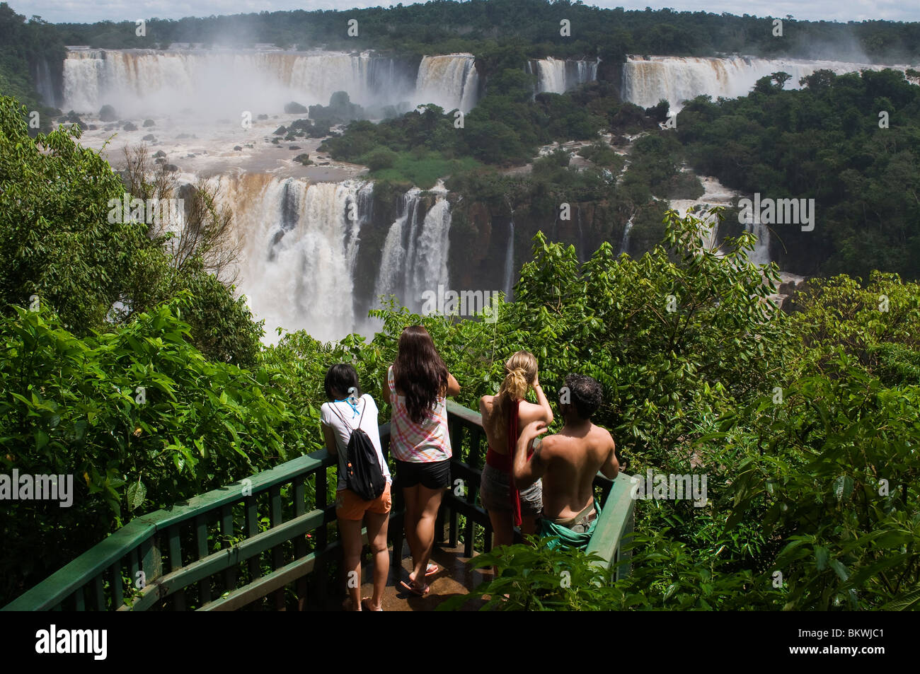 Tourists at Iguaçú Falls, one of the biggest falls in the world, Paraná state, Brazil - Stock Image